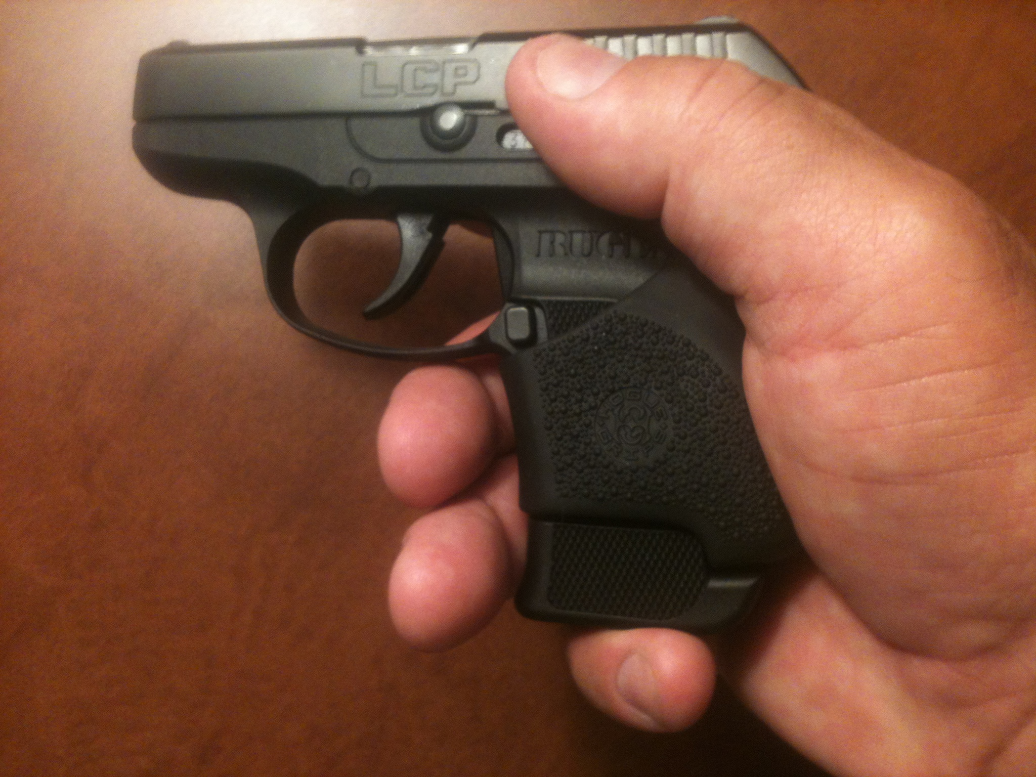 The Hogue Hybrid grip and 7 round Ruger magazine totaly